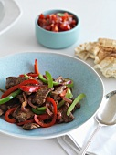 Stir fried beef with pepper and tomato salsa