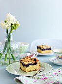 A table laid with blueberry tray bake cake