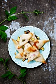 Samosas with pistachios, nectarines and ricotta