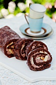 Chocolate Swiss roll with bananas and hazelnuts