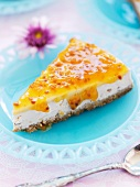 A slice of cheesecake with passion fruit sauce