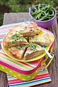 Potato tortilla with salami and green peppers