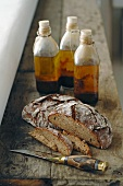Kitchen knife, bread and oil