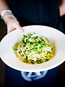 Spaghetti with smoked fish and broad beans