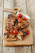 Grilled pork ribs with cocktail tomatoes