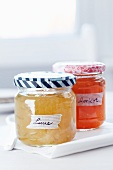 Jam jars with colourful masking tape on the lids and masking tape for labels