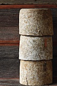 Three Wheels of Aged Sheep Cheese; Stacked