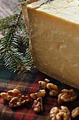 A Wedge of Hard Sheep Cheese with Walnuts; On Tartan