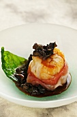 Scallops with giant African snail ragout