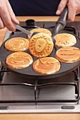 Pancakes being baked in a pancake pan