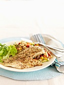 Fish fillet with lemons, pepper and couscous