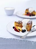 Nectarine cake with blueberries and cream