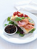 Unleavened bread with bacon and onion chutney