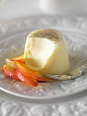Panna cotta with peach salad with a bite taken out