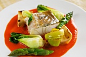 Steamed zander on red pepper creme with vegetables