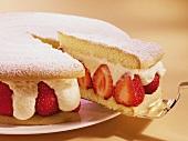Strawberry cake, a piece cut