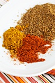 Indian spices: chilli powder, curry powder and ground cumin