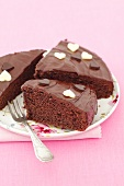 Chocolate cake with glaze and chocolate hearts