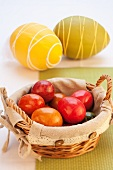 Colourful Easter eggs in a basket with decorated eggs