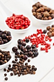 Allspice berries, pink pepper, juniper berries and black peppercorns