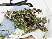 Fresh thyme on a kitchen towel