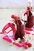 Homemade raspberry juice in small bottles