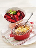 Apple and rice bake with baked damsons