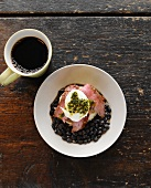 Steak and Eggs Over Black Beans; Topped with Sour Cream and Pesto; Cup of Coffee