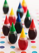 Food Coloring Bottles on Polk-a-Dot Surface
