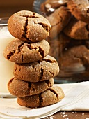 Stack of Molasses Cookies with a Glass of Milk; Jar of Cookies
