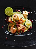 Courgettes with prawns and pomegranate seeds