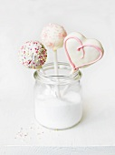 Cake pops in a jar of sugar