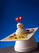 An alien made of pistachio ice cream and cocktail cherries