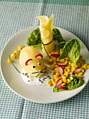 A potato mouse with herbal quark, cheese and salad