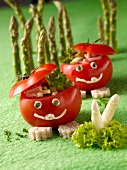 Funny tomato men in an asparagus forest