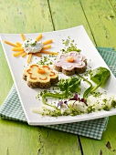 Bread flowers with cheese and ham and a carrot sun