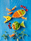 Belegte Brote mit Gemüse in Fischform