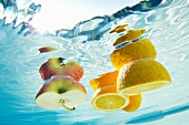 Fruit floating in swimming pool