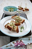 Bite-sized bread on sticks with herb butter