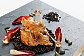 Roast partridge with myrrh, Beluga lentils and radicchio
