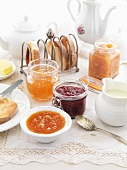 A breakfast table laid with toast and various types on jam