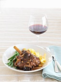 Braised knuckle of lamb and a glass of red wine
