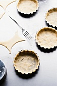 Shortcrust pastry in tartlet dishes