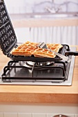 Freshly baked waffles in a waffle iron