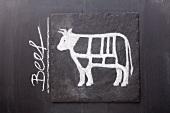 Gezeichnetes Rind auf einer Schiefertafel