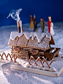 A winter scene with a gingerbread house