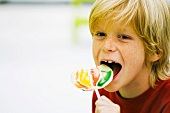 Boy eating lollipop