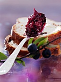 A spoonful of sloe jam and two slices of raisin bread