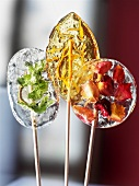 Homemade lollies with herbs, zest and fruit pieces