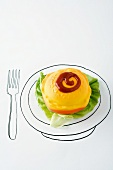 Plastic hamburger with lettuce and ketchup on drawing of plate